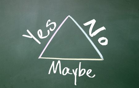 yes or no: yes, no, maybe sign on blackboard Stock Photo