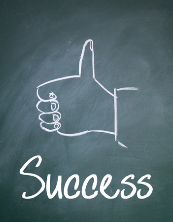 commend: success sign on blackboard