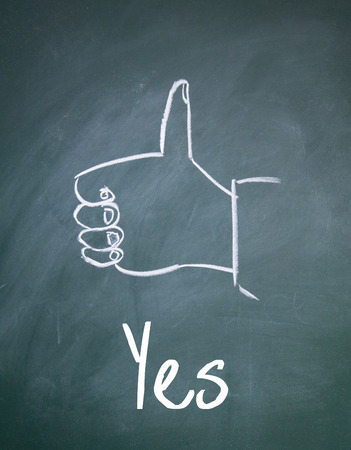 allowed to pass: yes sign on blackboard Stock Photo
