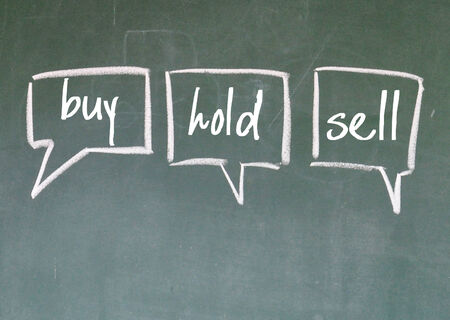 hold: buy, hold, sell think sign on blackboard Stock Photo