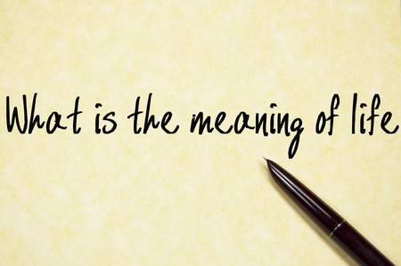 connotation: what is the meaning of life text write on paper Stock Photo