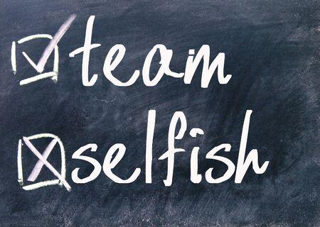 selfish: team and selfish choice on blackboard Stock Photo