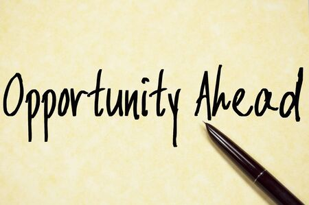 opportunity: opportunity ahead text write on paper