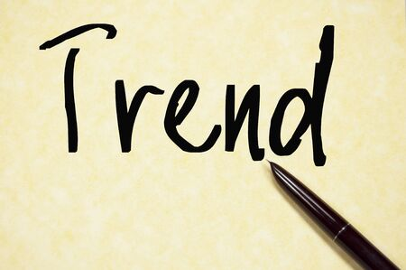 trend: trend word write on paper