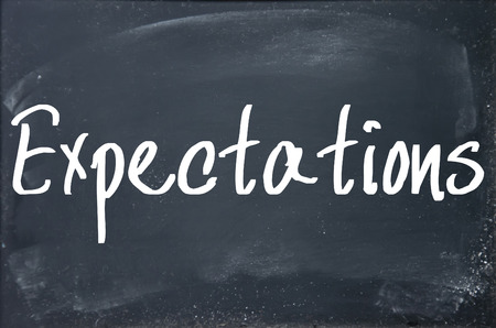 expectations word write on blackboard Banque d'images