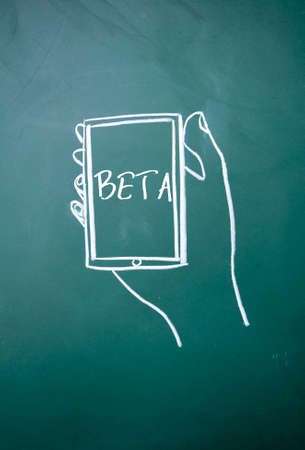 sns: beta word and smartphone sign on blackboard