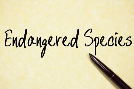 endangered species: endangered species text write on paper