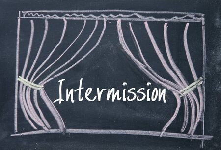 stage door: Intermission text and curtain background on blackboard Stock Photo