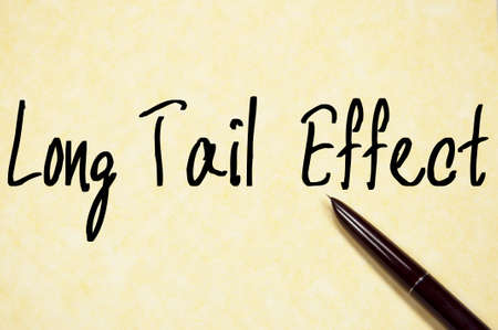long tail: long tail effect text write on paper