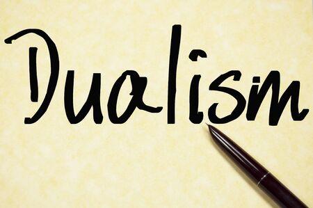 dualism: dualism word write on paper