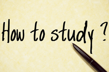 assiduous: how to study question write on paper Stock Photo