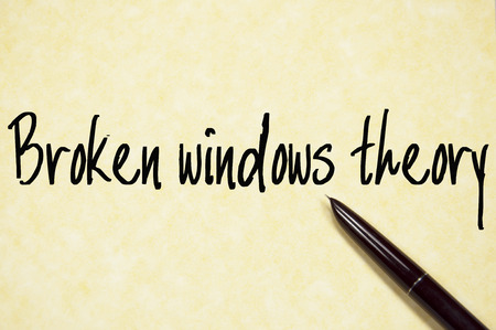 theory: broken windows theory text write on paper