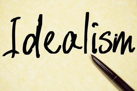 idealism: idealism word write on paper