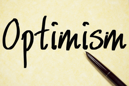 optimism: optimism word write on paper Stock Photo