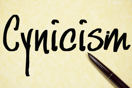 skeptical: cynicism word write on paper Stock Photo