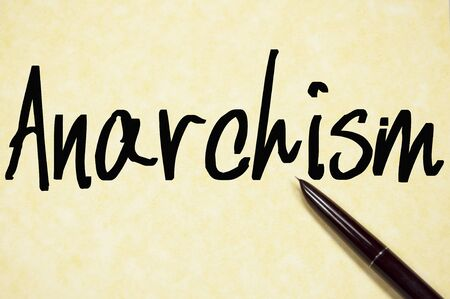 anarchism: anarchism word write on paper