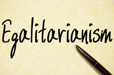 egalitarian: egalitarianism word write on paper