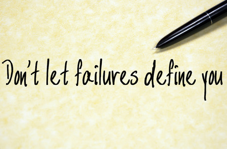 define: do not let failures define you text write on paper
