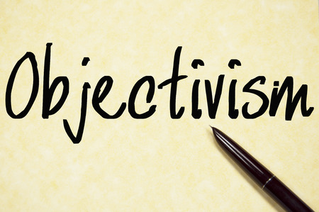 objectivism: objectivism word write on paper