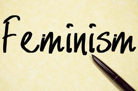 feminism: feminism word write on paper
