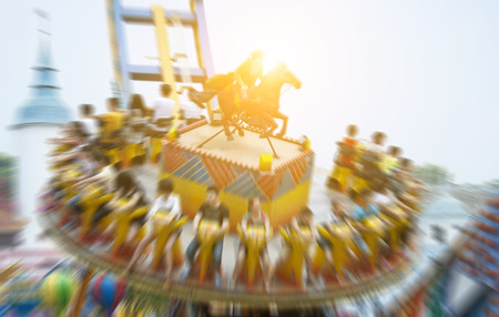 across: soaring across the skies in amusement park Stock Photo
