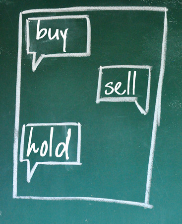 to sell: buy sell hold chat sign Stock Photo