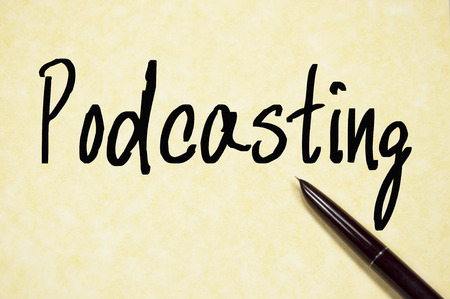 podcasting: podcasting word write on paper