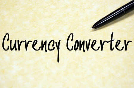 currency converter: currency converter text write on paper