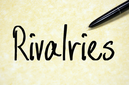 sibling rivalry: rivalries word write on paper Stock Photo