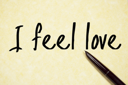 by feel: I feel love text write on paper Stock Photo