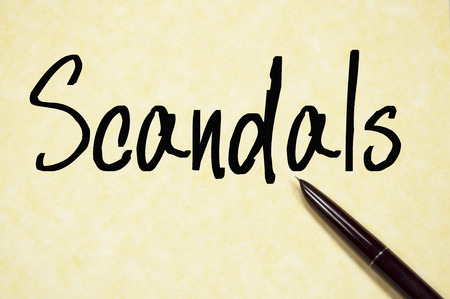 scandals: scandals word write on paper