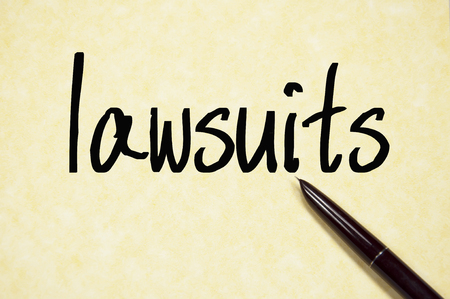 lawsuits: lawsuits word  write on paper