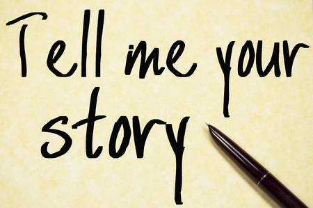 one story: tell me your story text write on paper Stock Photo