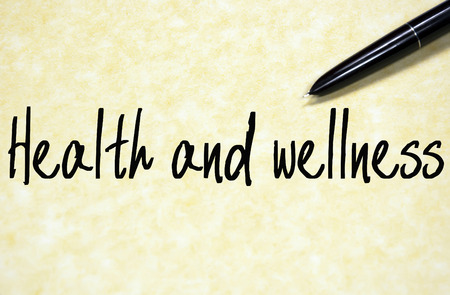 wellness: health and wellness text write on paper
