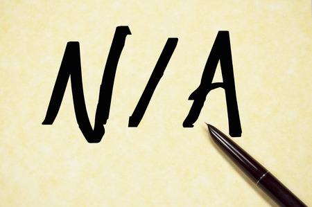 na: NA word write on paper Stock Photo