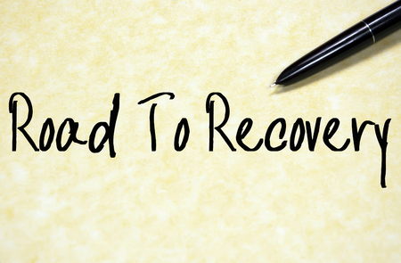 road to recovery: road to recovery text write on paper