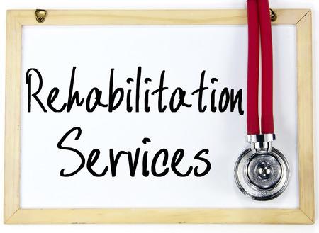 eldercare: rehabilitation services text write on blackboard Stock Photo