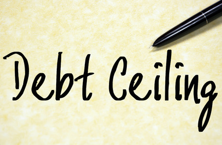 owing: debt ceiling text write on paper Stock Photo