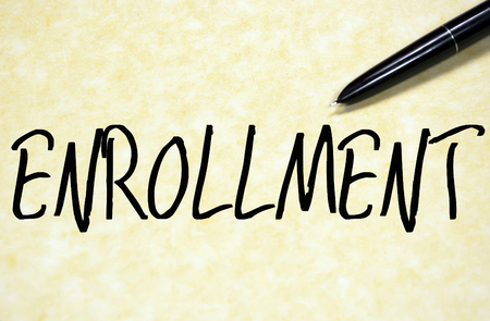 enrollment: enrollment word write on paper Stock Photo