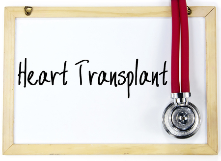 transplant: heart transplant text write on whiteboard Stock Photo