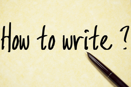 writes: how to write question write on paper Stock Photo