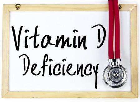 witaminy: Niedobór witaminy D tekst pisać na tablicy Zdjęcie Seryjne