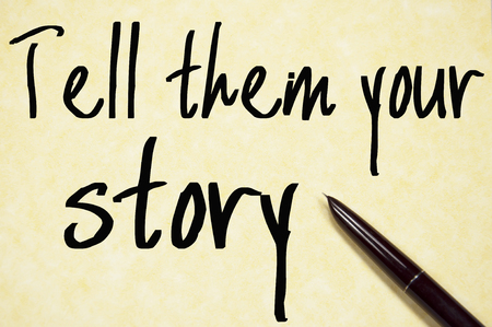 them: tell them your story text write on paper Stock Photo