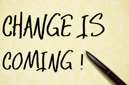 change direction: change is coming text write on paper