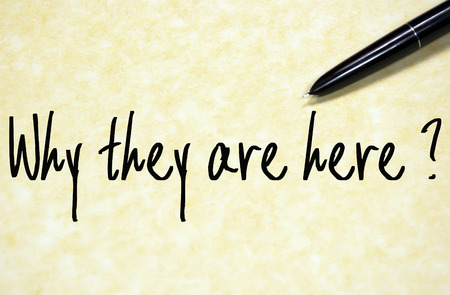 they: why they are here question write on paper Stock Photo