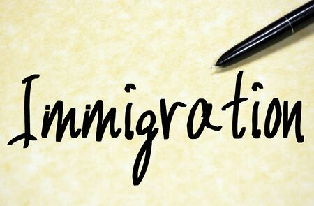naturalization: immigration word write on paper
