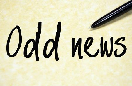 odd: odd news text write on paper