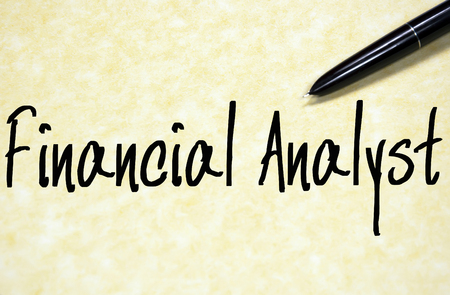 analyst: financial analyst text write on paper Stock Photo