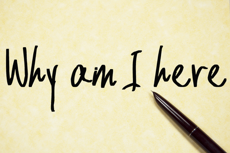 i am here: why am I here text write on paper