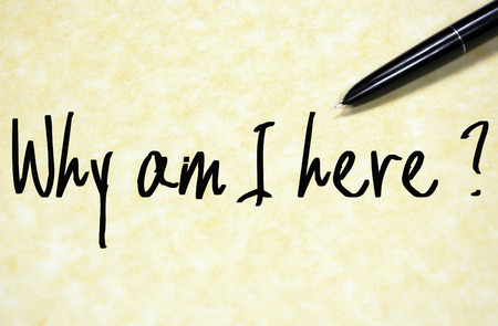 i am here: why am I here question write on paper Stock Photo